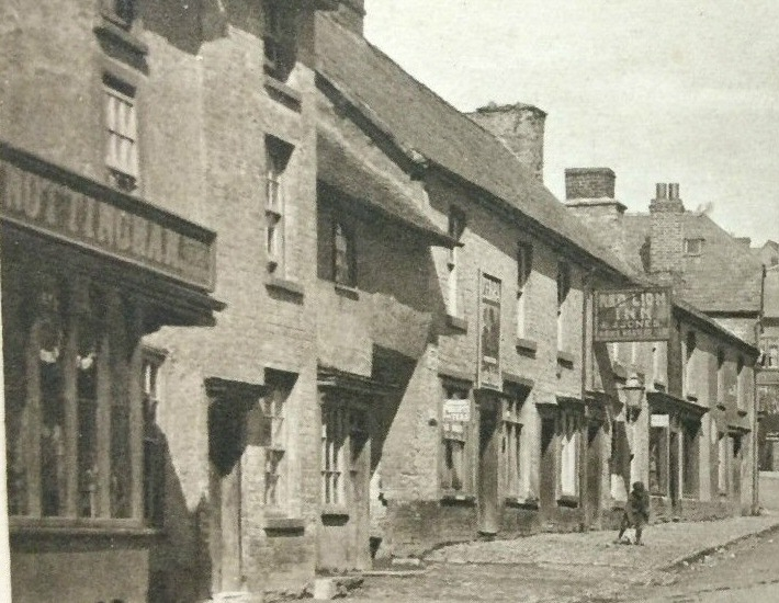 c1911 No. 43, left, is Benjamin Nottingham, a grocer/provision dealer.   No 45 was the private house of George Pryce, Postman. No 47 was James Grimster, Shoemaker.  No 53, past the opening to Red Lion Shut, is a Confectioners run by Arthur Richards. Has large PEARS SOAP sign and Phillips Tea sign on wall.  No 55 is the private house of Richard Gough General labourer.
